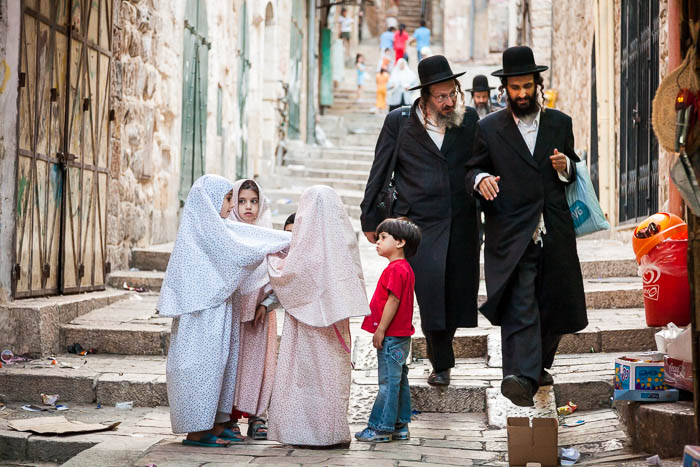 Orthodox Jewish men and Muslim children in Jerusalem (2006)